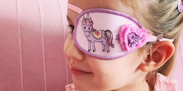 Девочка с повязкой на глазу