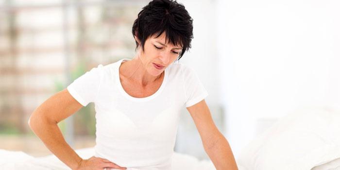 Боли в нижней части живота у женщины