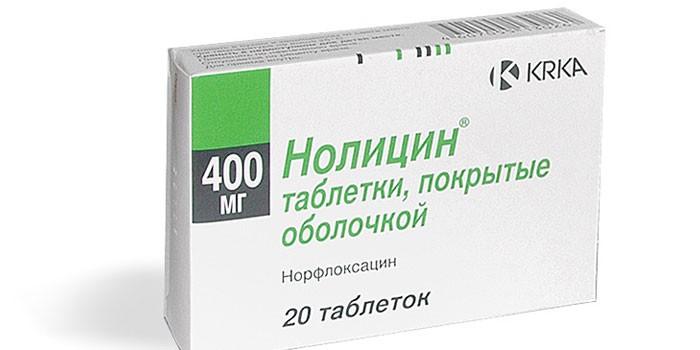 Таблетки Нолицин в упаковке