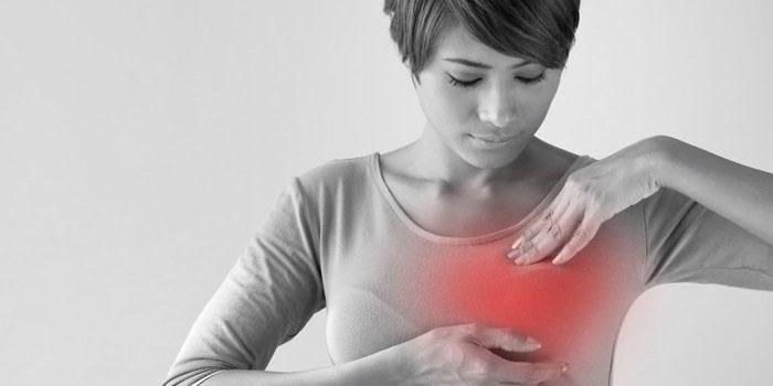 Боль в молочной железе у женщины